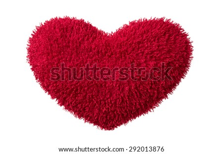 A isolated red plush  heart on white background - stock photo
