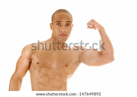 A Jamaican young man standing from the front and shoeing his biceps for white background.