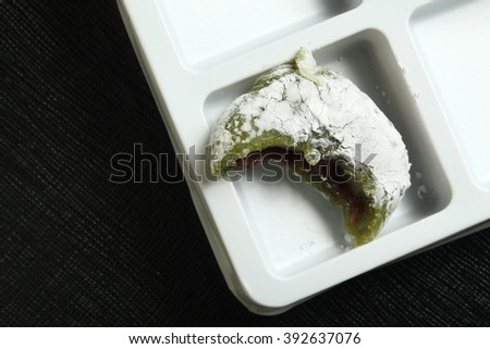 A japanese green tea mochi represent japanese traditional confectionery and food concept related idea. - stock photo