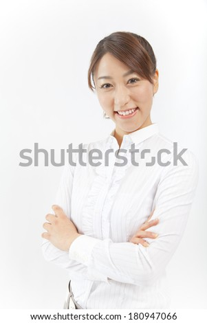 A Japanese office lady smiling with folded arms,