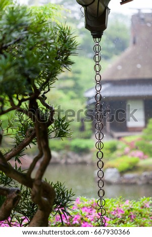 A Japanese rain chain or kusari-doi which is a traditional rain drainage system found in many Japanese temples and houses. The chain directs rain water from the roof gutters to the drains.