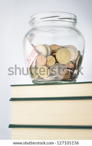 A jar of coins with savings for education - stock photo