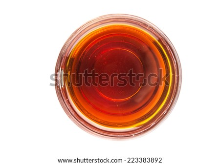 A jar of honey over white background - stock photo
