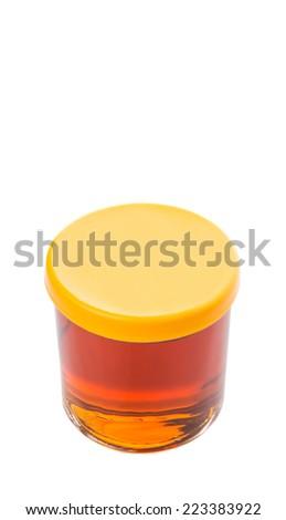 A jar of honey over white background