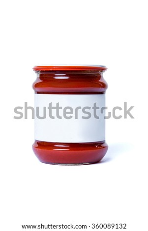 a jar with tomato paste and white label is isolated on a white background. - stock photo