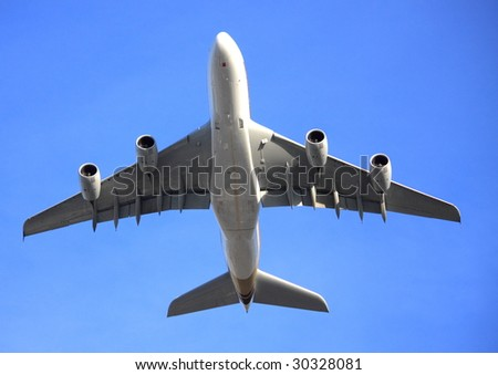 A380 jet aircraft flying low overhead