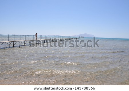 A jetty extending out into the Red Sea at Sharm El Sheikh in Egypt. It is a windy in April and the temperature is around 30c.