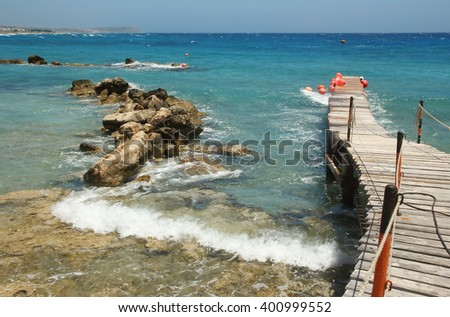 a jetty on the beach background - stock photo