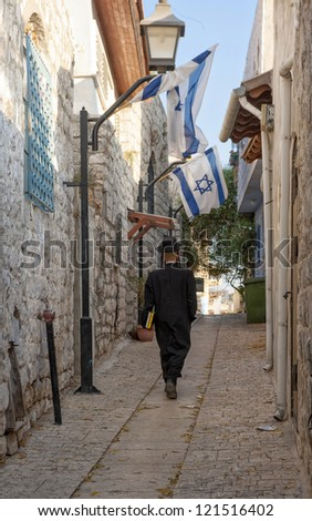 A Jewish Man on the street of Zefat (Safed) - stock photo
