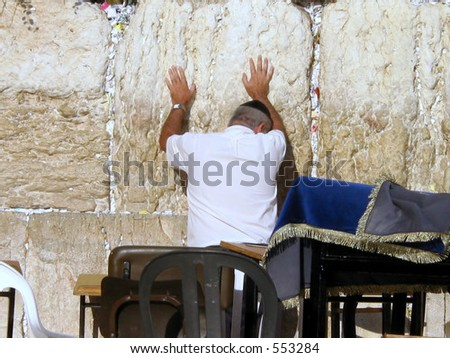 A Jewish person prays with intention at the wailing wall in Jerusalem israel - stock photo