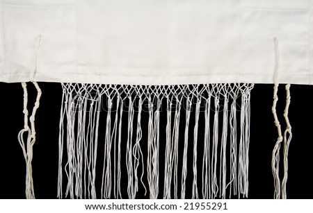 A Jewish prayer shawl, or tallit, showing the fringes, called tzitzit