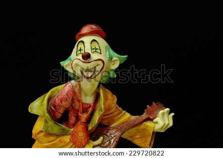 a joker in dark background.  - stock photo