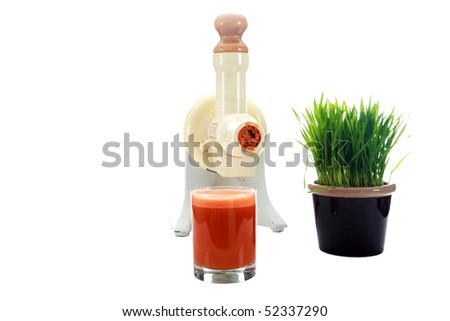 a juicer with carrot juice and wheat grass isolated on white - stock photo