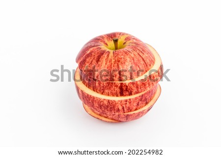 A juicy red apple is displayed in five individual sections. - stock photo