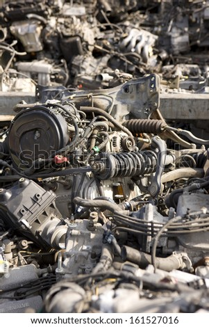 A jumble of auto parts and wires. - stock photo
