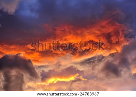 A jumble of stratocumulus clouds at sunset. Suitable as an abstract, natural graphics background. - stock photo