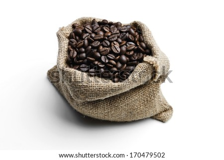 A juta bag with roasted coffee beans, on White background - stock photo