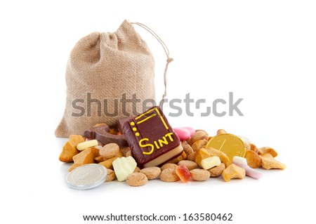 "A jute bag full of pepernoten, for celebrating a dutch holiday "" Sinterklaas ""  on the fifth of December - stock photo"