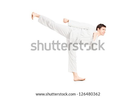 A karate man exercising isolated against white background