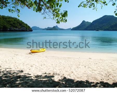 A Kayak boat on a beach of Angthong Marine National Park, Thailand - stock photo