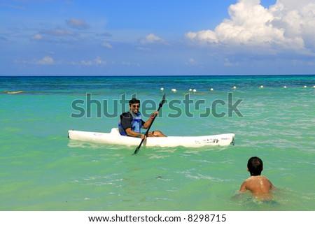 A kayak man saving the life of a kid - stock photo