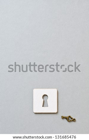 a key and paper keyhole - stock photo