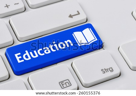 A keyboard with a blue button - Education - stock photo