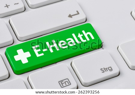 A keyboard with a green button - E-Health - stock photo