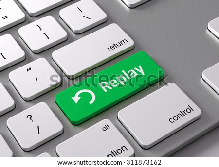 A keyboard with a green button-Replay