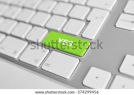 A keyboard with a green button - Yes - stock photo