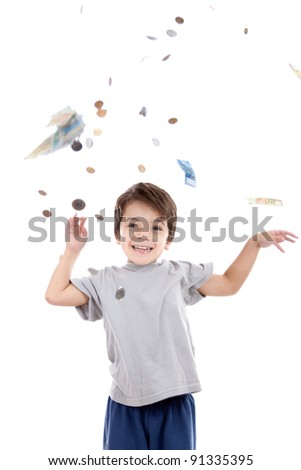 A kid above a rain of Brazilian money which is called Real. He is looking to the viewer and smiling happily with a feeling that the money is coming easily. Isolated on white. - stock photo