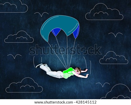 A Kid Going Sky Diving - stock photo