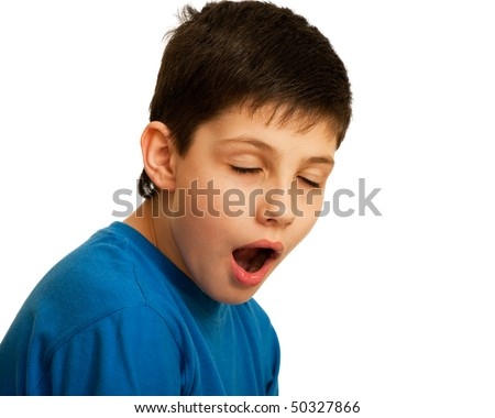 A kid is yawning with closed eyes; isolated on the white background