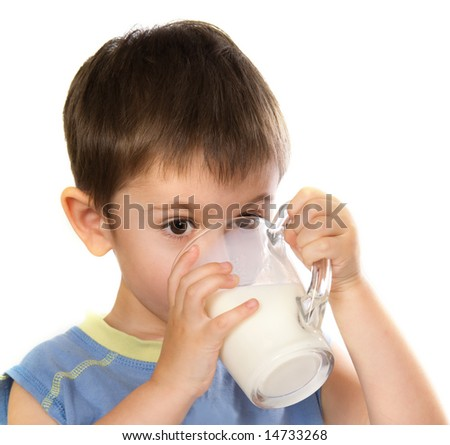 A kid's drinking some milk - stock photo
