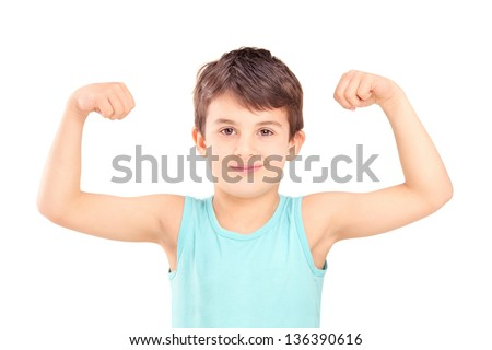 A kid showing his muscles isolated on white background - stock photo