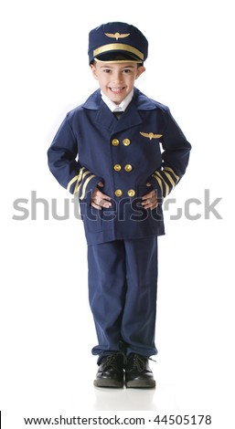A kindergarten boy standing proudly in an oversized airline pilot's uniform.  Isolated on white.