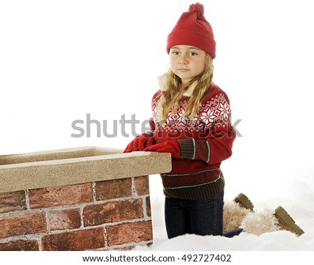 A kindergarten girl sadly waiting on a snowy roof by the chimney.
