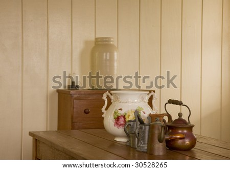 A kitchen scene in an early american home with pewter and crockery