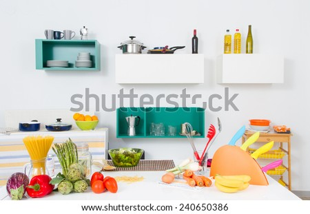 A kitchen with healthy food and a lot of utensils - stock photo