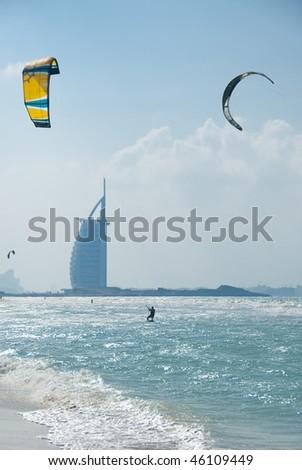 a kite surfer in action along the Jumeirah beach, Dubai - stock photo