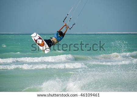 A kitesurfer displaying his skills in the sport - stock photo