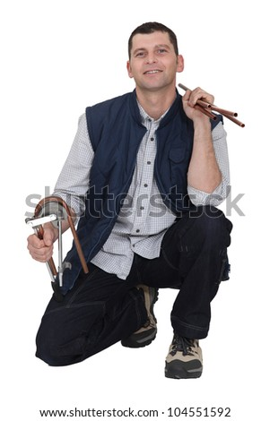 A kneeled plumber. - stock photo