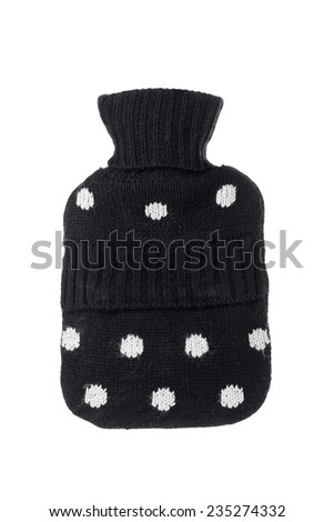 A Knitted Hot Water Bottle Cover Isolated on a White Background. - stock photo