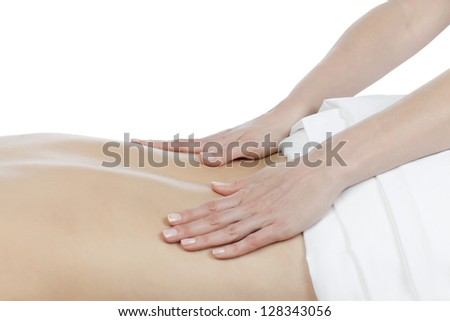 A lady having a lower back massage on the spa by the masseur