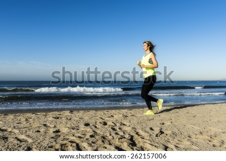 A lady running on the beach
