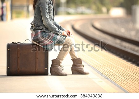 A lady waiting at the railway station - stock photo