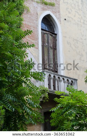 A lancet window with shutters and balcony  in Venice, Italy - stock photo