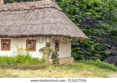 a landscape clay and wooden hut thatched Ukrainian - stock photo