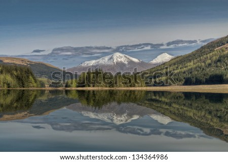A Landscape Image with Snowy Mountain, Forest, Lake and Reflection - stock photo