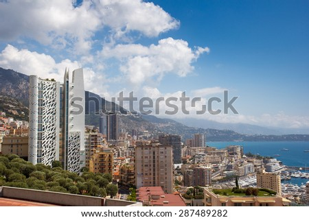 A landscape of Monaco with a mountain in the background
